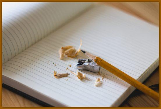 broken_pencil_on_clean_notebook